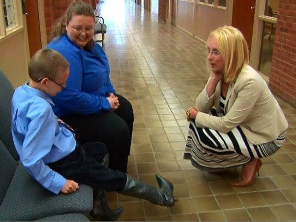 "Joseph and his mother meet Mayor Lydia Mihalik to ask if she'll sponsor him, as he runs a mile in high heels for Findlay Open Arms ""Walk a Mile in Her Shoes."""